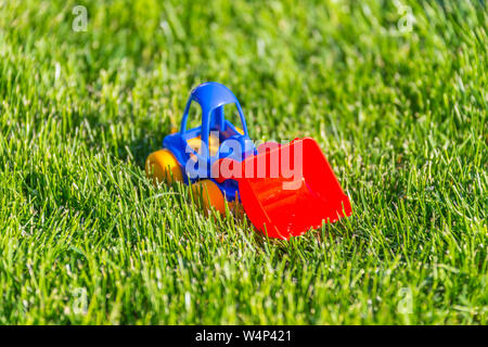 plastic toy car on a green grass - Stock Photo
