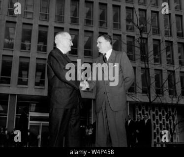 President Harry S Truman shakes hands with NASA Administrator James E Webb during a presidential visit to the newly opened NASA Headquarters in Washington, District of Columbia, November 3, 1961. Image courtesy National Aeronautics and Space Administration (NASA). () - Stock Photo