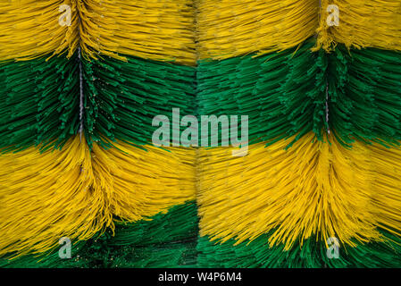 Big brushes of automatic machine Car Wash. Caring for a vehicle. Colored dynamic background - Stock Photo