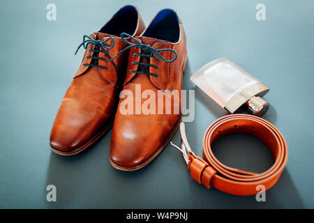 Businessman's accessories. Brown leather shoes, belt, perfume. Male fashion. Morning of groom - Stock Photo