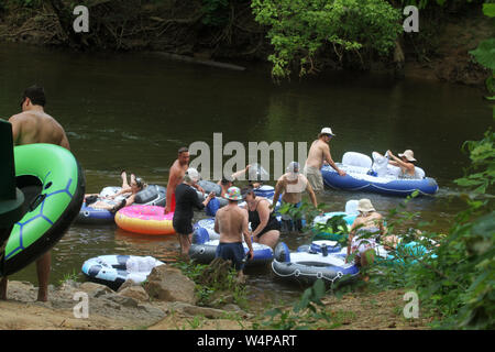People tubing on Neuse River in North Carolina, USA - Stock Photo
