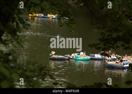 People tubing on Neuse River in North Carolina, USA - Stock Photo