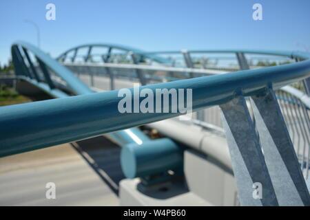 Handrail of pedestrian bridge over highway. - Stock Photo