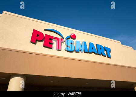 Close-up of logo and sign on facade of Petsmart pet supply store in Dublin, California, July 23, 2018. - Stock Photo