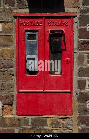 An old postage stamp dispenser in Sun Close off Eton High Street, Windsor Berkshire, UK. 23rd July, 2019. Credit: Maureen McLean/Alamy - Stock Photo