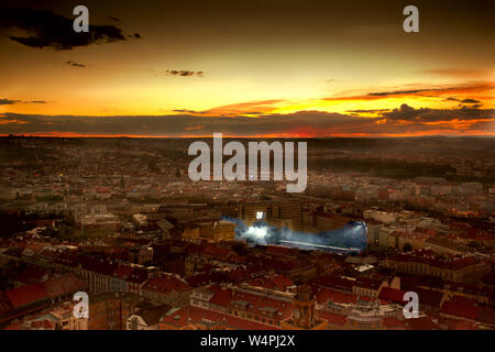 Epic sunset over city with football stadion - Stock Photo