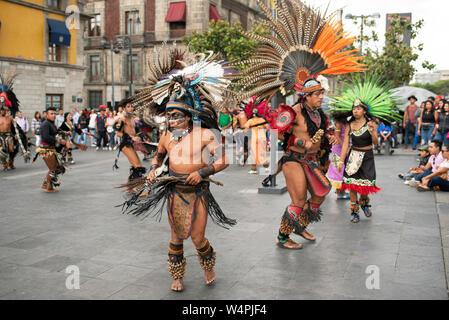 Aztec dancers (concheros) performing ritual dance at the Zocalo, Mexico City, CDMX, Mexico. Jun 2019 - Stock Photo