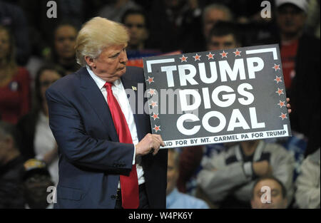 Republican Presidential nominee Donald Trump holds a sign that reads 'Trump Digs Coal' during a rally Oct. 10, 2016, at Mohegan Sun Arena in Wilkes-Ba - Stock Photo