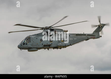A British Royal Navy Agusta Westland Merlin HM2 helicopter participating in the flying display at Yeovilton Air Day, UK on the 13th July 2019. - Stock Photo