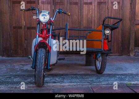Red Hipster motorcycle - Stock Photo