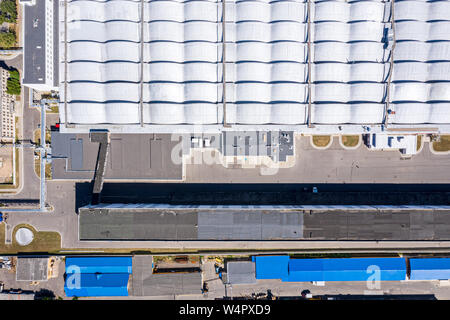 aerial top view of roof of industrial building or warehouse - Stock Photo