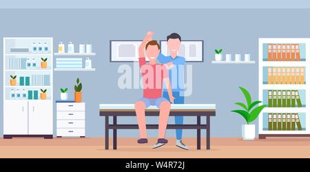 man patient sitting on table masseur therapist doing healing treatment massaging patient body manual sport physical therapy concept modern clinic - Stock Photo