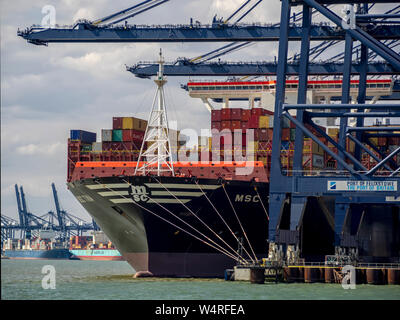 FELIXSTOWE, ESSEX:  The Port with container ship being unloaded - Stock Photo