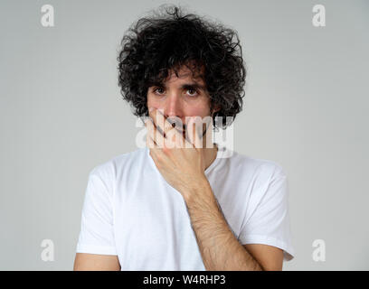 Portrait of young sad man, worried and concerned, looking depressed and desperate. Feeling sorrow and fear. With white copy space. In People, facial e - Stock Photo