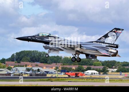 Belgian Air Force General Dynamics F-16 Fighting Falcon in D-Day colours arriving at RIAT Air Show, RAF Fairford, Gloucestershire, UK