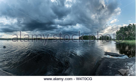 Approaching storm at the lake, Finland - Stock Photo