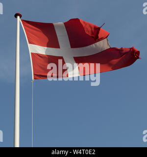 Danish flag blowing in wind, Denmark - Stock Photo