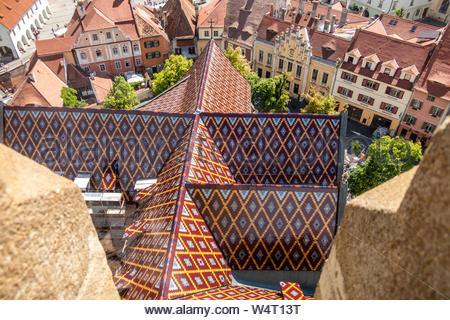 View of the renowned cathedral roof from the tower of the Lutheran Cathedral of Saint Mary in Sibiu, Transylvania, Romania - Stock Photo