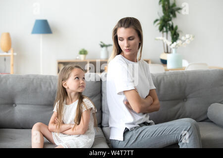 Mother and daughter looking to each other after quarrel - Stock Photo