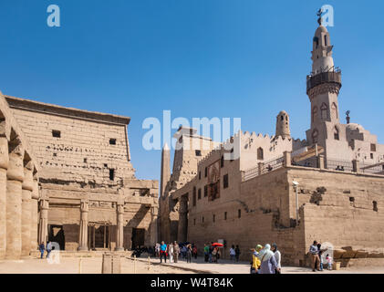 Mosque at Luxor Temple, the ancient and new religions meet, western tourists and locals. The Mosque of Abu Haggag is one of the oldest in Egypt - Stock Photo