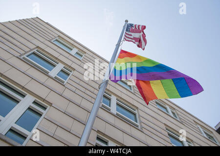 Berlin, Germany. 25th July, 2019. A rainbow flag hangs under a US flag at the US embassy. The 41st Berlin Christopher Street Day will take place on Saturday 27 July. Credit: Jörg Carstensen/dpa/Alamy Live News - Stock Photo