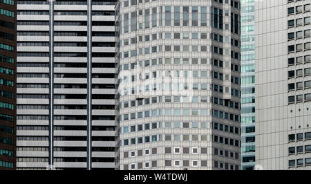 Modern futuristic glass building abstract background. Exterior of office glass building architecture. Facade of financial center business building. En - Stock Photo