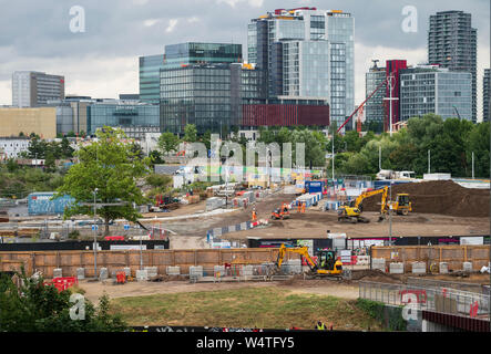 East Wick and Sweetwater development building site in the Queen Elizabeth Olympic Park, East London, UK, with the International Quarter behind. - Stock Photo
