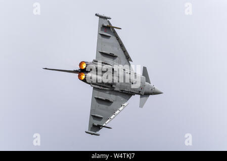 Italian Air Force Eurofighter F2000 Typhoon jet fighter plane flying at Royal International Air Tattoo airshow, RAF Fairford, Cotswolds, UK. Reheat - Stock Photo
