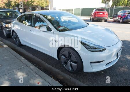 Tesla Model 3 automobile parked along a street in the Silicon Valley town of Mountain View, California, October 28, 2018. () - Stock Photo