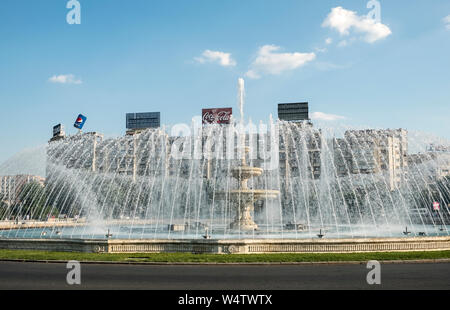 Bucur Fountain in Piața Unirii (Unification Square), Bucharest, Romania. There is a spectacular display with music on weekend evenings during summer - Stock Photo