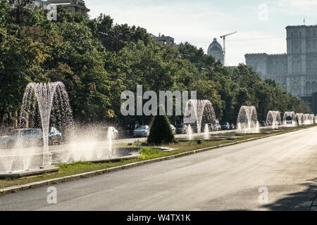 Fountains on Unirii Boulevard, Bucharest, Romania (Bulevardul Unirii). It runs from Piața Unirii (Unification Square) to the Palace of the Parliament - Stock Photo