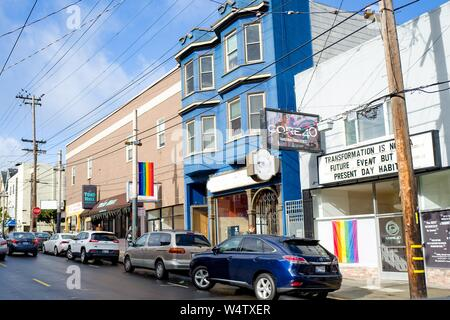 Numerous LGBT rainbow pride flags are visible on a sunny day on 18th street in the Castro District of San Francisco, California, known as one of the major centers of LGBT culture in the United States, December, 2018. () - Stock Photo