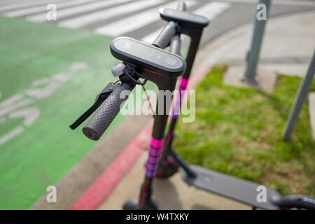 Two sharing economy electric scooters from rideshare company Lyft are parked along a street in Santa Monica, California, with Lyft logo visible, December 10, 2018. () - Stock Photo