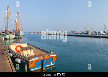boats on a calm sunny morning in the small fishing village of Brixham, Devon, UK - Stock Photo