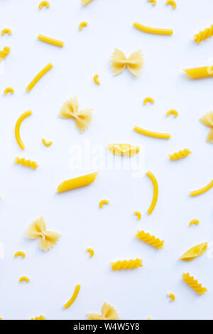 Different types of dry pasta on white background - Stock Photo