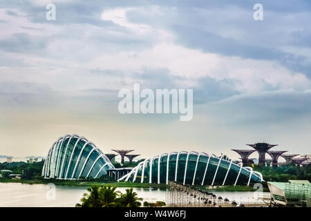 Singapore - Dec 21 , 2018: Gardens by the bay at Marine Bay with Flower Dome,  Cloud Forest, Supertree Grove and Marina Barrage in view, Singapore. - Stock Photo