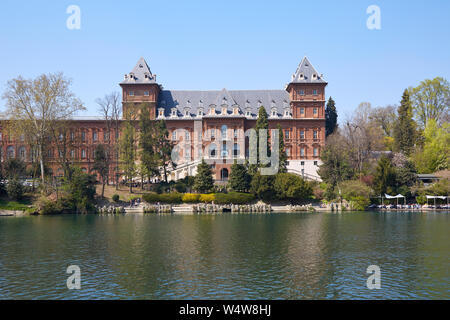 TURIN, ITALY - MARCH 31, 2019: Valentino castle red bricks facade and Po river, sunlight in Piedmont, Turin, Italy. - Stock Photo
