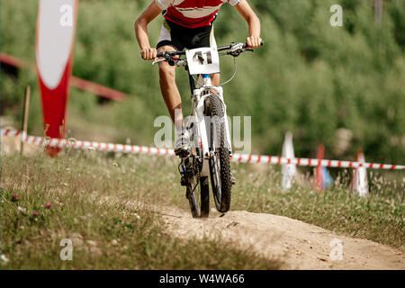 athlete mountain biker cross country racing in mountain bike - Stock Photo