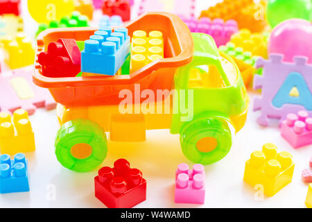 Colorful Kids toys on white background.