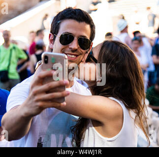 Couple in love take a selfie photograph together in front of the Spanish Steps in Rome, italy - Stock Photo