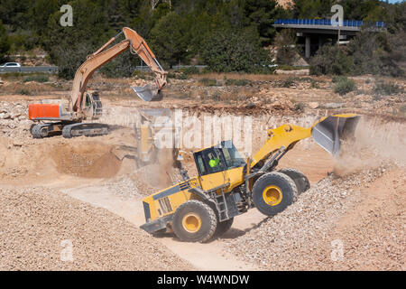 Excavator machines working in the construction site - Stock Photo