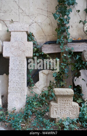 Old headstones in the courtyard of Stavropoleos Monastery, Bucharest, Romania. - Stock Photo