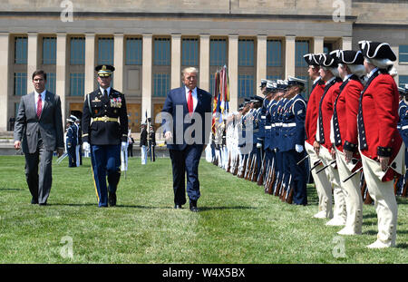 United States President Donald J. Trump (R) reviews troops with the new US Secretary of Defense Dr. Mark T. Esper (L) and US Air Force General Paul J. Selva, Vice Chairman of the Joint Chiefs of Staff, at the Pentagon, Thursday, July 25, 2019, Washington, DC. The Department of Defense has been without a full-time leader since former Secretary Jim Mattis resigned in December 2018. Credit: Mike Theiler/Pool via CNP /MediaPunch - Stock Photo