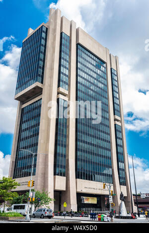 New York City, USA - August 1, 2018: Facade of the Adam Clayton Powell Jr. State Office Building with people around in Harlem, Manhattan, New York Cit - Stock Photo