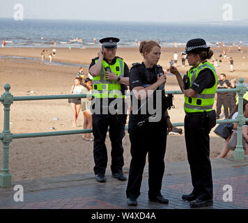 Portobello, Edinburgh, Scotland, UK. 25th July 2019. At around 17.30 on Thursday evening at least ten Police cars where in evidence beside the promenade as they had been called regarding trouble occurring between youths on Portobello Beach. By 18.30 most of the youths had been dispersed. Leaving a mess on the sand of discarded clothing and rubbish. - Stock Photo
