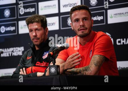 East Rutherford, USA. 25th July, 2019. Atletico de Madrid soccer team player Saul Niguez (R) speaks during a press conference at Metlife stadium in East Rutherford, New Jersey, USA, 25 July 2019. Atletico de Madrid will face Real Madrid as part of International Champions Cup on 26 July 2019. Credit: Kena Betancur/EFE/Alamy Live News - Stock Photo