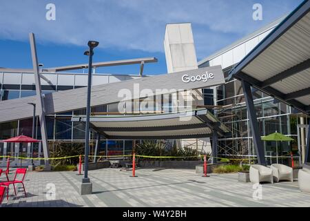 Facade with logo at the Googleplex, headquarters of Google Inc in the Silicon Valley, Mountain View, California, April 13, 2019. () - Stock Photo