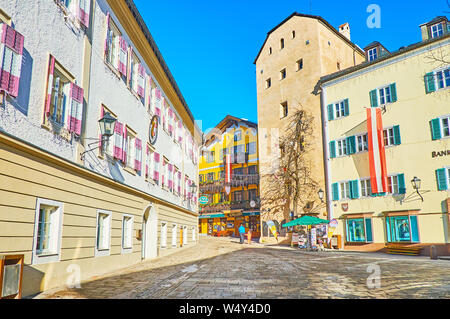 ZELL AM SEE, AUSTRIA - FEBRUARY 28, 2019: The old traditional housing in Stadtplatz - the central square of resort with popular cafes, souvenir stores - Stock Photo