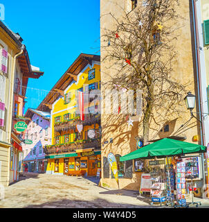 ZELL AM SEE, AUSTRIA - FEBRUARY 28, 2019: The city center boasts scenic townhouses and traditional edifices of popular tourist hotels, old restaurants - Stock Photo