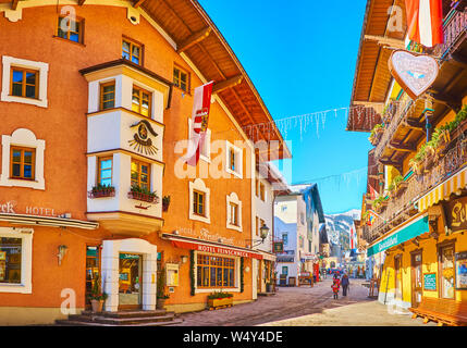 ZELL AM SEE, AUSTRIA - FEBRUARY 28, 2019: The street of Altstadt (Old Town) is lined with scenic historical buildings - hotels Feinschmeck and Lebzelt - Stock Photo